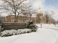 Buffalo State sign in front of Rockwell during winter
