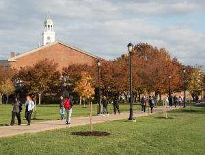 Image of students walking on path near Rockwell in the Fall