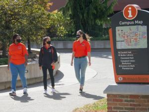 Students wearing face masks while walking on campus